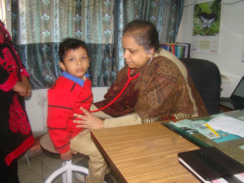Dr. Examining baby